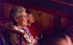 Older woman watching performance